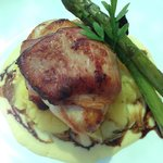Chicken wrapped in bacon served with mashed potato, asparagus and a beautiful sauce.
