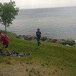 Kids Playing in front of Hotel a the Rocky Shoreline