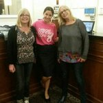 Shelley jane and Sandra Fisher with Carlota.  Supporting breast cancer care.