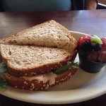 Cranberry Turkey on wheat with fruit side.