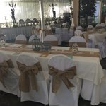 Our tables decorated and the food service area in back ground