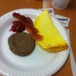 Hot breakfast; sausage, bacon and omelette