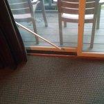 Useless security bar for sliding glass door.