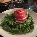 Tomato and mozzarella on baby arugula