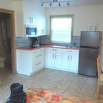 Perfect kitchen with full sized fridge and microwave and ceramic cook top