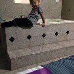 My child modeling the jacuzzi!