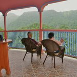 Contented guest enjoying the balcony of Calabash Villa