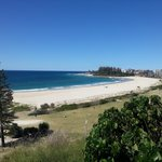 Coolangatta Beach is closest to the lone pine tree, Greenmont Beach is just before the group of