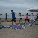 Private beach yoga for your group. Email us.