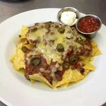 Cheesy Nachos: melted cheese, salsa, jalapenos.
