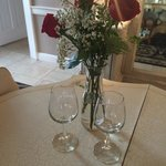Wine glasses and roses upon arrival
