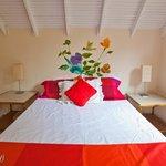 Garden View Apartment Red Bedroom