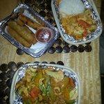 Clockwise from bottom: Cashew chicken, spring rolls, and chicken massaman curry.