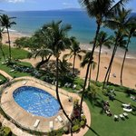Pool, lawn, beach and ocean at Hale Pau Hana Beach Resort