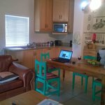 Well equipped kitchen with dining table