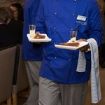 Prisoner in training serving dessert
