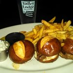 Tenderloin mini sandwiches on pretzel rolls. Served with creamy horseradish, au jus, pickle spea