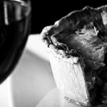 A Glass of wine with one of our Gourmet Pies