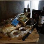 Breakfast basket - bread, butter, olive oil, bacon, eggs, etc