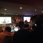Two of 4 big screens behind the bar.