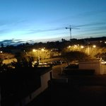 view of free (in October) car park from appartment at night
