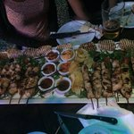 Chicken skewers and grilled halloumi