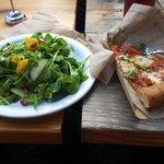 Arugula salad and vegetarian pizza