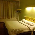 Room clean cozy...with wood floor