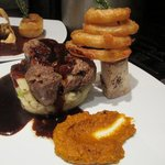 Slow cooked beef shin, beer battered onion rings, champ mash, roast carrot puree, beefy ale grav