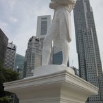 Statue of Raffles against the modern commercial backdrop.