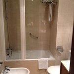 bathroom with one bath towel, one hand towel, one floor mat