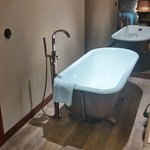 Our bedroom at Hotel Teatro - standalone bathtub)