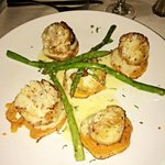 Sauteed scallops on sweet potato slices with asparagus