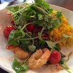Prawns with chorizo, oven roasted cherry tomatoes, salad greens and saffron rice