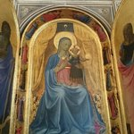 The Virgin enthroned with child and musician angels by Fra Angelico