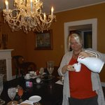 Angela serving coffee at breakfast