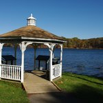 A gazebo in the park along the lake front.