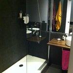The bathroom, large shower, basin & toilet
