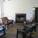 Open back porch sitting area with fireplace