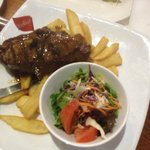 Medium char grilled Sirloin Steak with salad & fat chips.