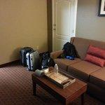couch in living area of king suite (door to adjoining room)