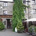 The Old Mill Inn front entrance and outdoor gardens
