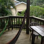 private porch with hammock and dining table/chairs