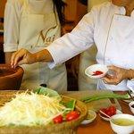 Learning how to make Som Tum (papaya salad)