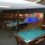 Pool tables and dart boards in their downstairs game room.