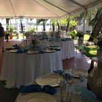 Tables set up under the tent at Tropical Resort & Marina