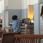 My kid, getting his own serving from d buffet table.