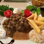 Steak with a mushroom and cream sauce