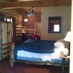 King bedded side of duplex cabin. Sitting area and walk in closet!