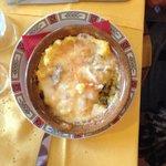 """Polenta """"concia"""" con vari formaggi locali fusi e gorgonzola"""